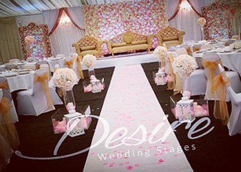 Asian wedding stage with flowerwall and large mirrors
