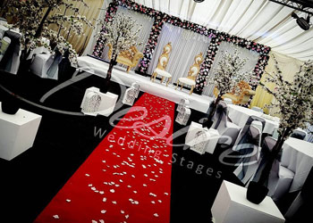 Foilage / Floral Asian wedding stage with red walkway
