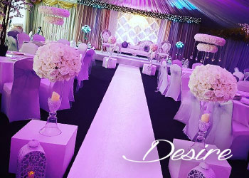 floral Asian wedding stage with centerpieces