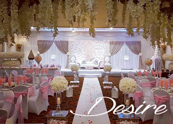 Beautiful Asian wedding setup with floral wall and white walkway